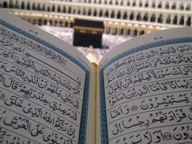 The Kaaba in Makkah with a Qur'an